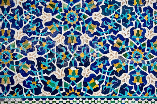 World famous tile work at the great iwan (or portal) of Jame (or Jameh or Friday) Mosque with mosaic decoration. Jameh Mosque is having the tallest portal of all mosques in Iran. This mosque (in local language called Masjid-e Jame) was built in the 14th century a.d. and is one of the main touristic highlights in the desert town of Yazd, Iran.