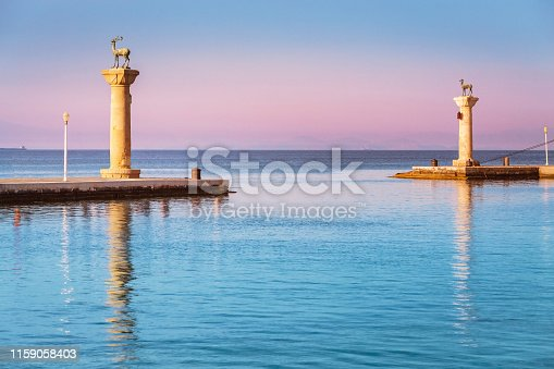 istock Famous tourist destination in Mandraki port with deers statue, where The Colossus was standing. Rhodes, Greece 1159058403