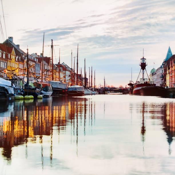 Famous touristic place in Copenhagen - Nyhavn. stock photo