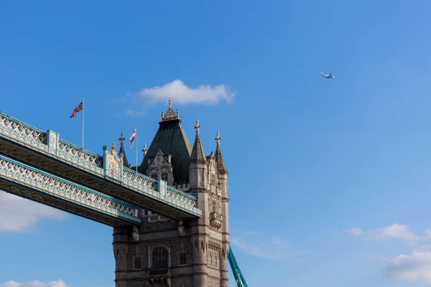 Famous Tower Bridge, London, UK People walking on the Thames Promenade with London Tower Bridge in background. bascule bridge stock pictures, royalty-free photos & images