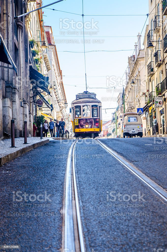Famous tramway number 28 going down the street stock photo