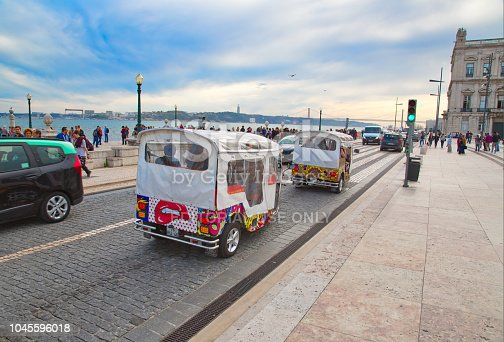Lisbon, Portugal-20 October, 2017: Famous Tuk Tuk transportation, a convenient way to see narrow streets of Lisboa