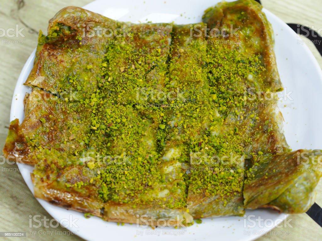 famous turkey gaziantep dessert (katmer) on white plate royalty-free stock photo