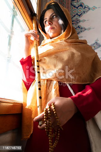 Famous Turkish reed flute artist. sufi muslim woman in mosque. islamic religion