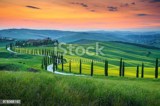 istock Famous Tuscany landscape with curved road and cypress, Italy, Europe 978368192