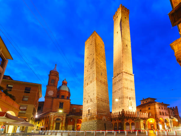 Famous Two Towers of Bologna at night, Italy stock photo