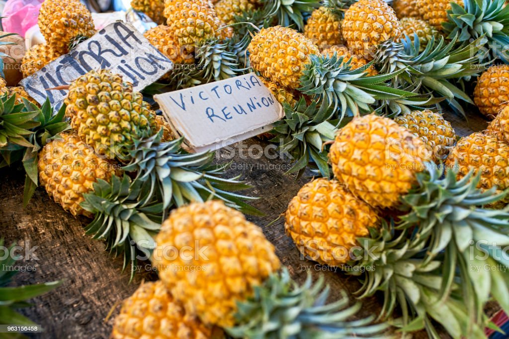 famous victoria pineapple on local market of reunion island stock photo