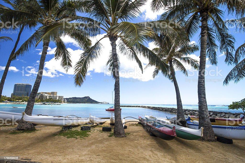Famous Waikiki Beach with Diamond Head on a sunny day stock photo