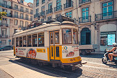 Lisbon, Portugal - June 15, 2017: Famous yellow tram 28 in Lisboa on Largo Luís de Camoes square