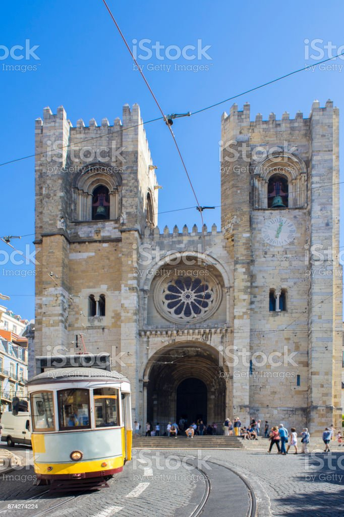 Famous yellow tram running in front of Se Cathedral in Lisbon stock photo