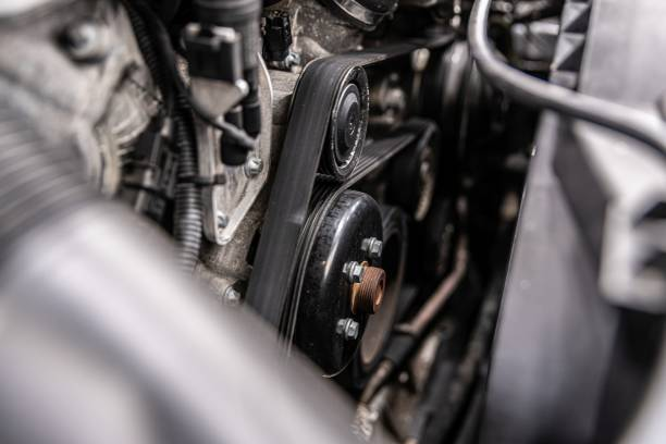 Fan belt and v-belt powering alternator, water pump and air conditioner compressor. stock photo