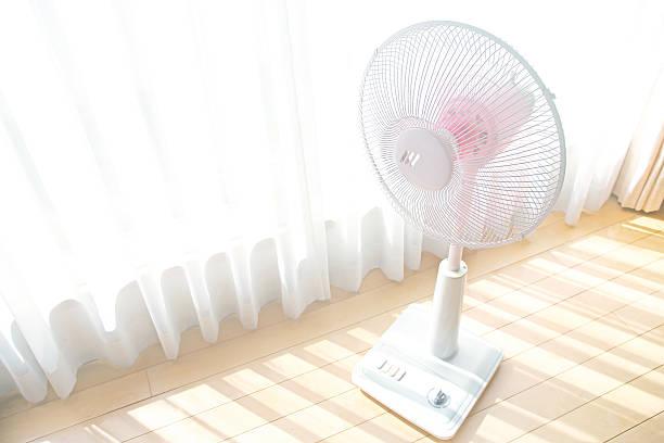 Fan by window. stock photo