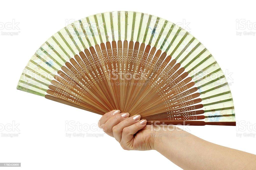 Fan in a woman hand royalty-free stock photo