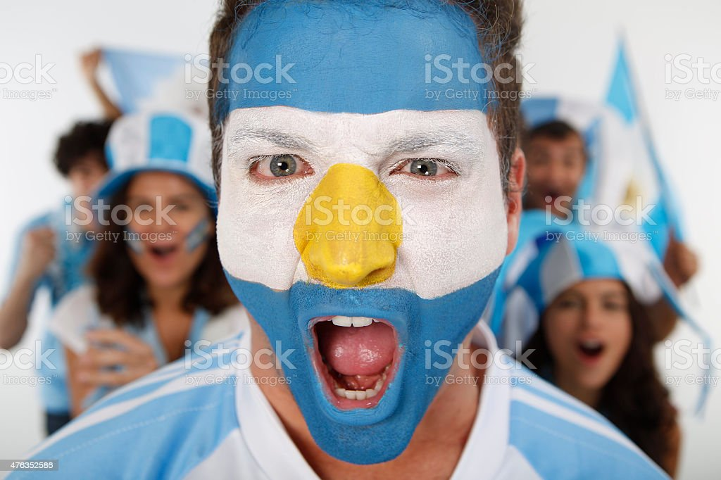 Fan of Argentina shouting a goal scored stock photo