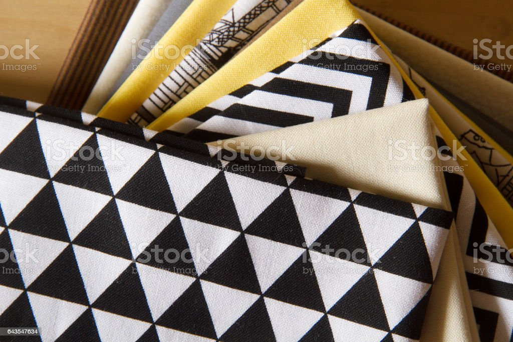 Fan of cotton fabrics with modern styled patterns стоковое фото