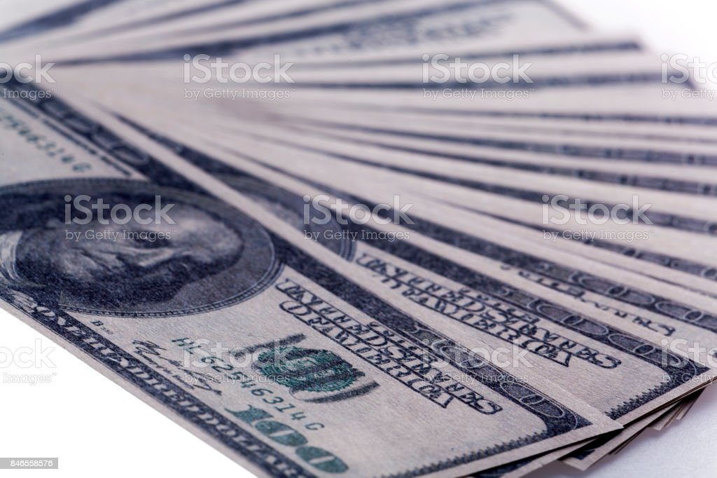 Fan of dollar bills isolated on white background stock photo