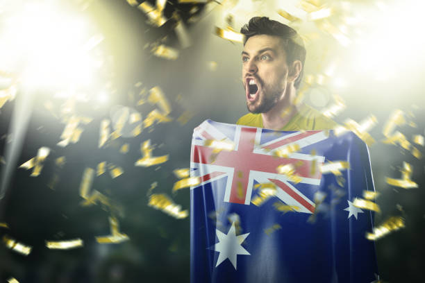 Fan / Sport Player holding the flag of Australia, celebrating stock photo