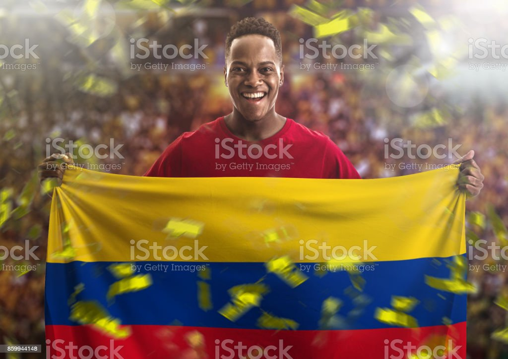 Fan / Sport Player holding the flag of Colombia stock photo