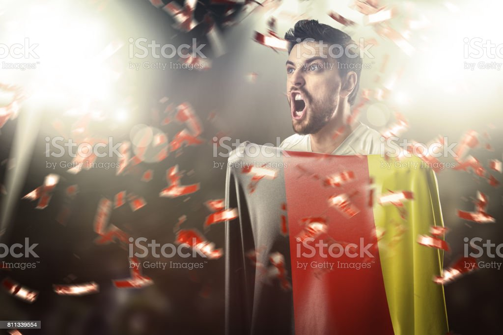 Fan / Sport Player holding the flag of Germany, celebrating stock photo