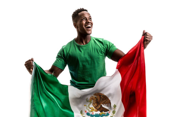 fan / sport player holding the flag of mexico - sports championship stock photos and pictures