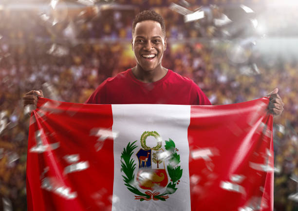 fan / sport player holding the flag of peru - peruvian ethnicity stock pictures, royalty-free photos & images
