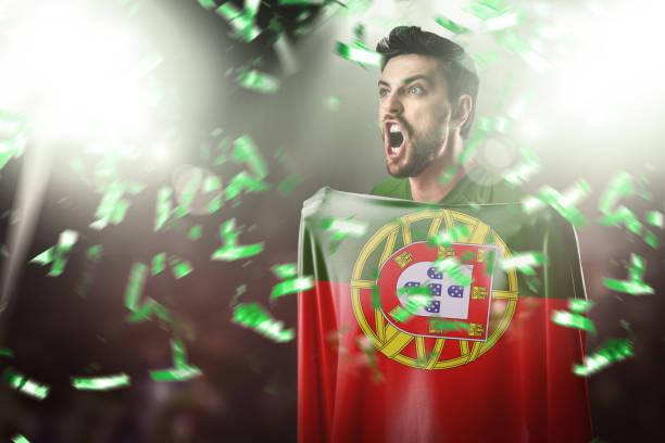 fläkt / sport spelaren håller flaggan för portugal, firar - football portugal flag bildbanksfoton och bilder