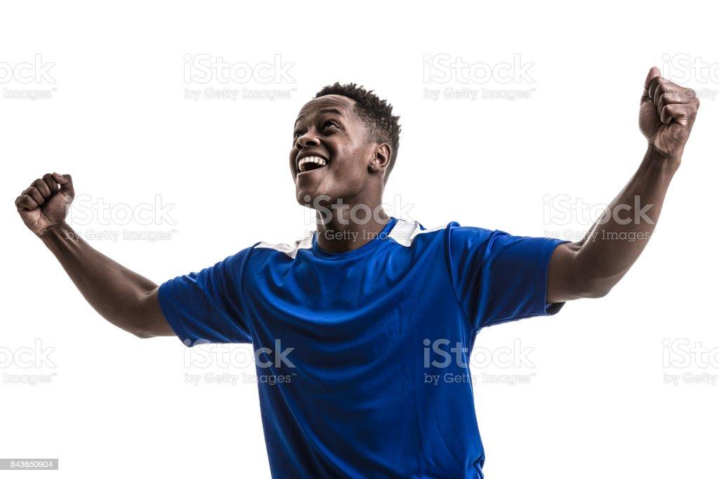 Fan / Sport Player on blue uniform celebrating on white background stock photo