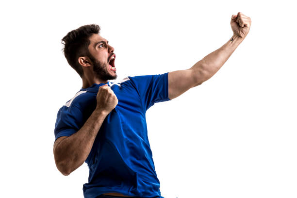 fan / sport player on blue uniform celebrating on white background - soccer league stock pictures, royalty-free photos & images