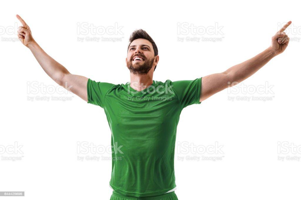 Fan / Sport Player on green uniform celebrating on white background stock photo