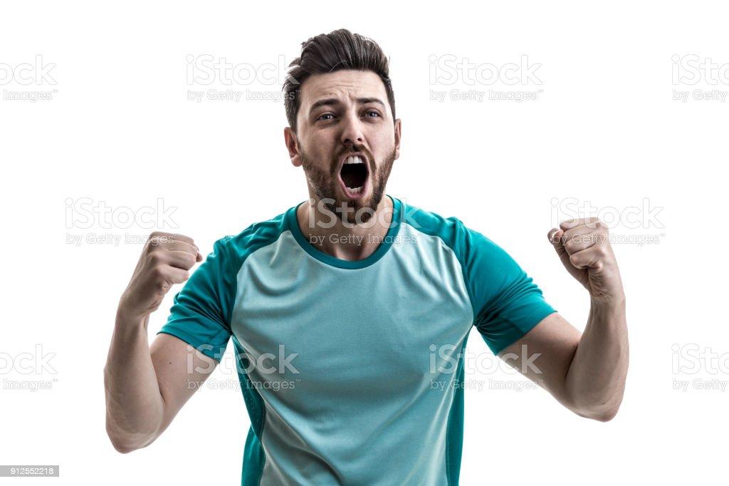 Fan / Sport Player on green uniform celebrating stock photo