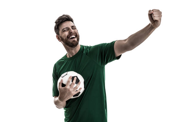 fan / sport player on green uniform celebrating - european culture stock photos and pictures