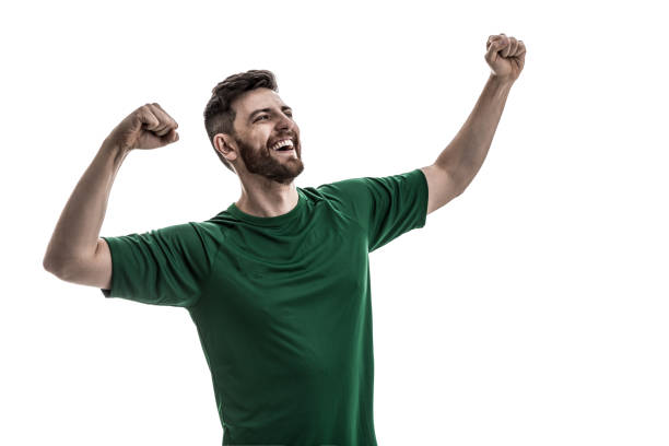 Fan / Sport Player on green uniform celebrating stock photo