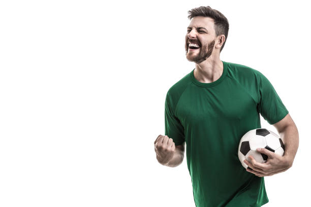 fan / sport player on green uniform celebrating - sports championship stock photos and pictures