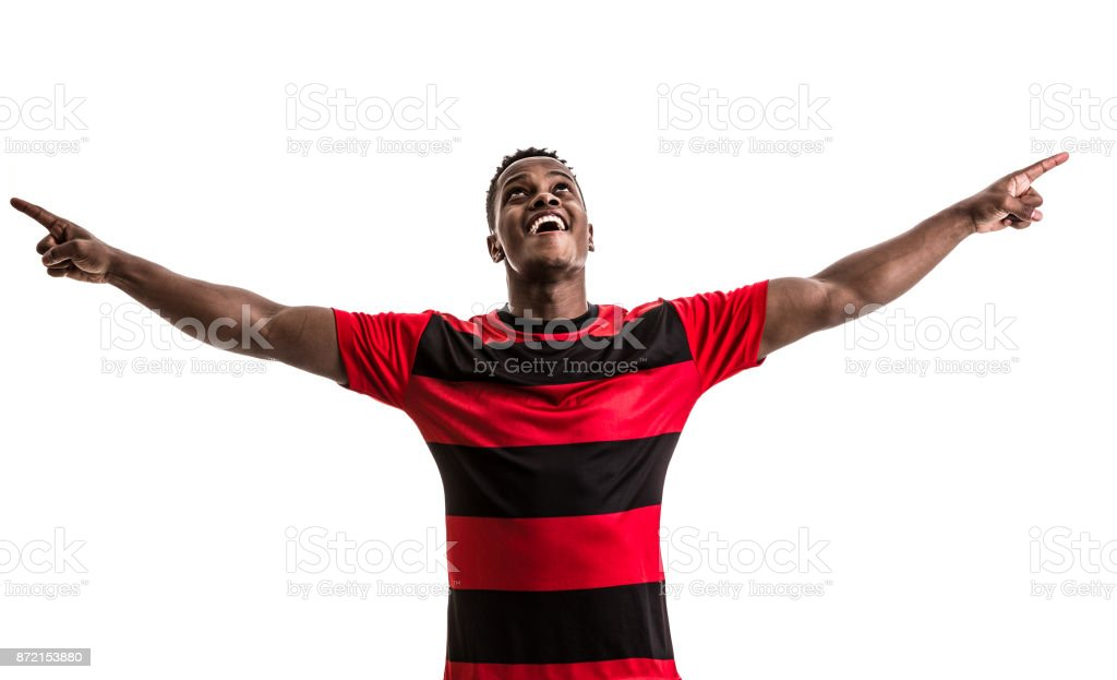 Fan / Sport Player on red and black uniform celebrating on white background stock photo