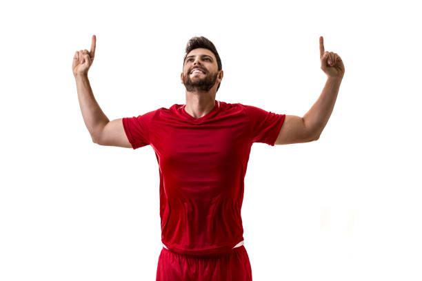 sexy / sport speler op rode uniform viering op witte achtergrond - internationale voetbal stockfoto's en -beelden
