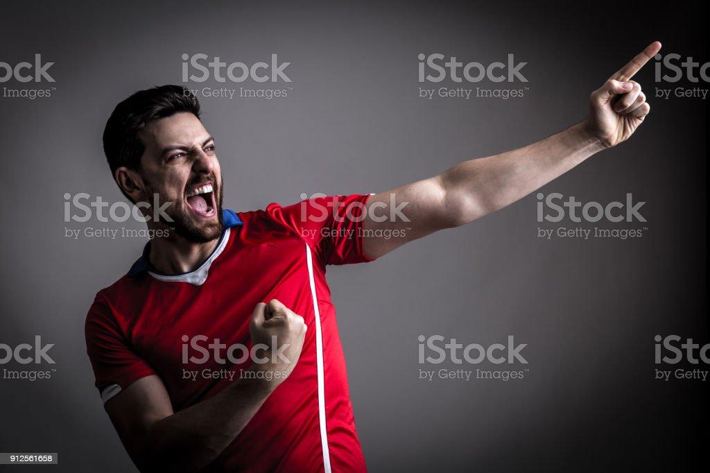 Sexy / Sport speler op rode uniform vieren foto