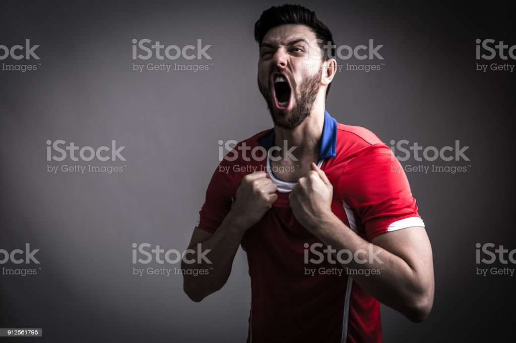 Fan / Sport Player on red uniform celebrating stock photo