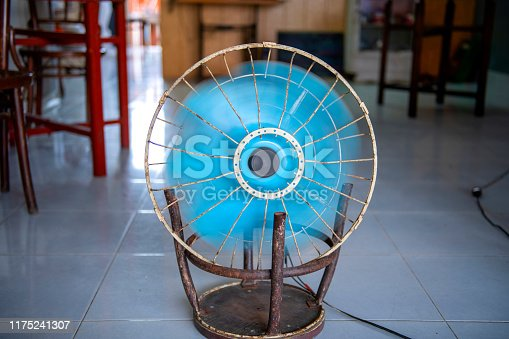 istock fan that is adapted to the steel chair 1175241307