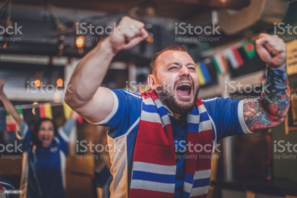 Fan watching a game stock photo