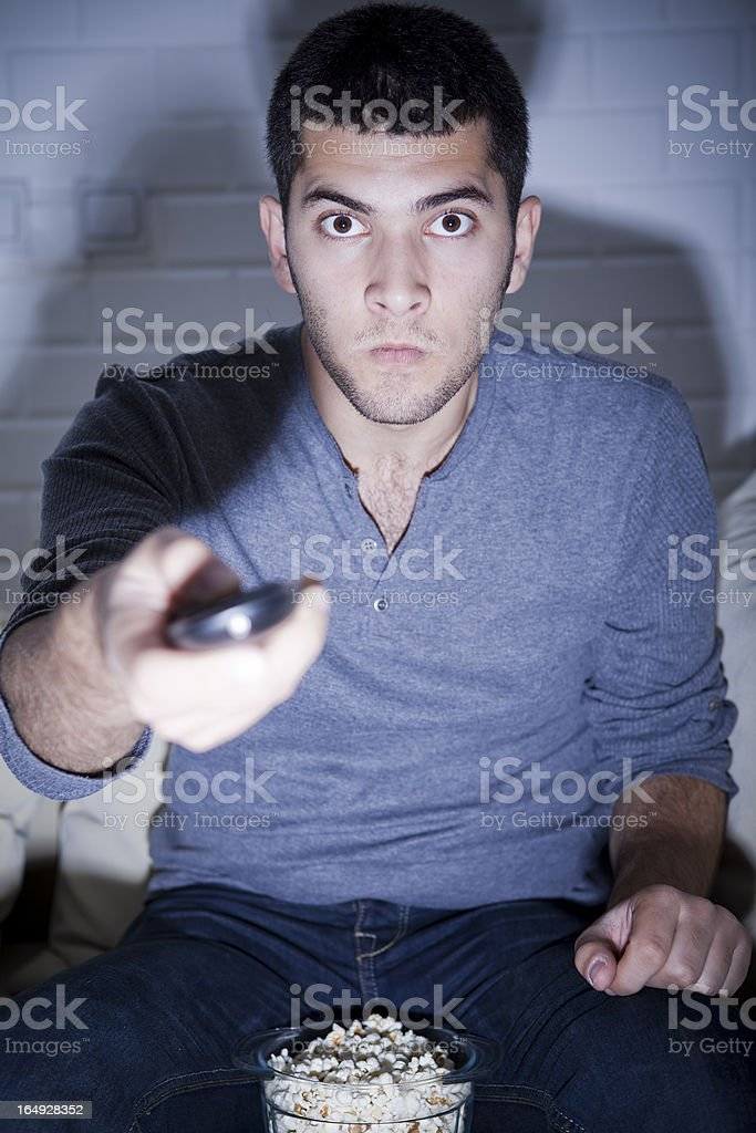 Fan watching match on TV stock photo