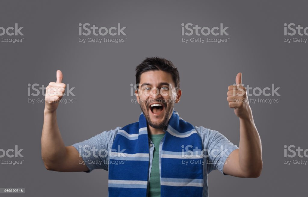 Fan with blue scarf stock photo