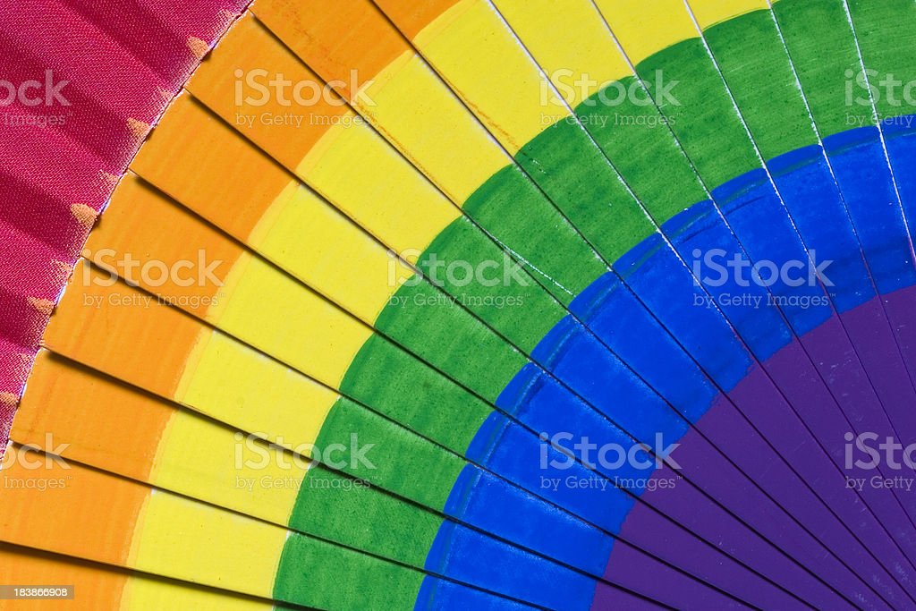 Fan with rainbow colours hand painted stock photo