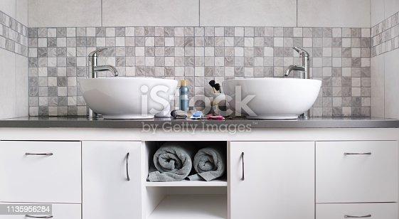Shot of master bathroom sinks and vanity in luxury home