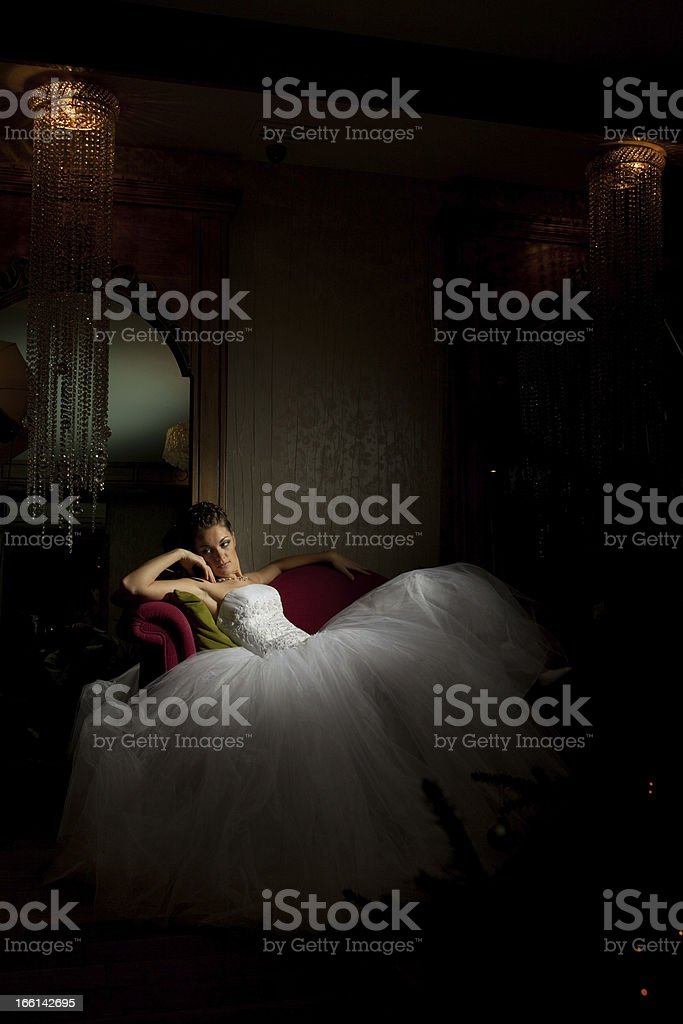 Fancy Bride Sitting on the Sofa. stock photo