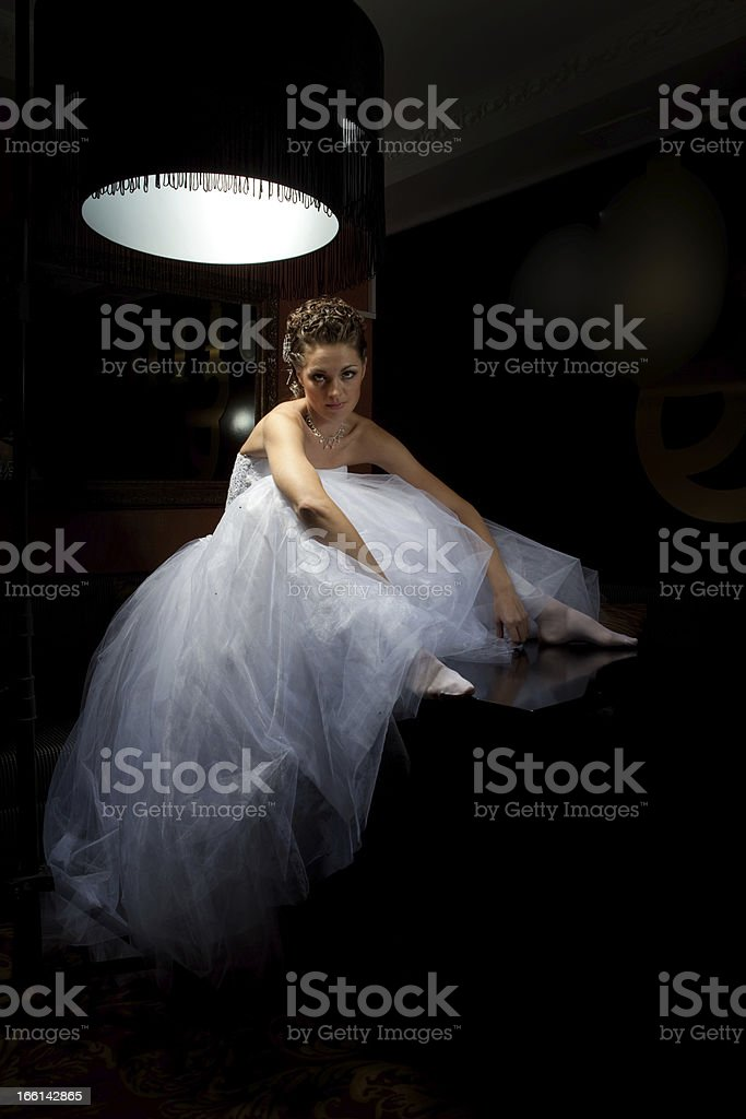 Fancy Bride Sitting on the Table. royalty-free stock photo