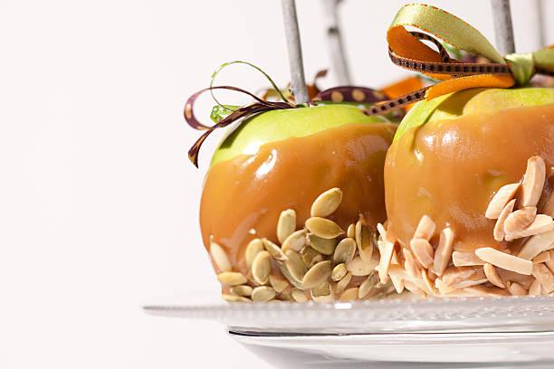 Fancy carmel apples on a plate stock photo