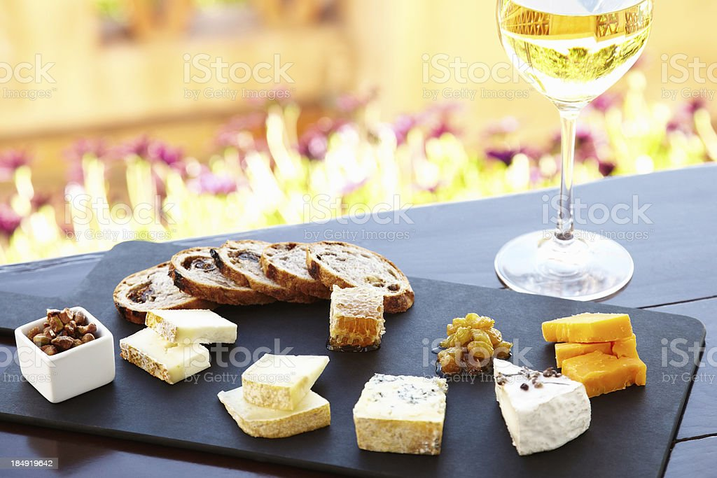 Fancy cheese plate with bread and honey outdoors royalty-free stock photo & Fancy Cheese Plate With Bread And Honey Outdoors Stock Photo \u0026 More ...