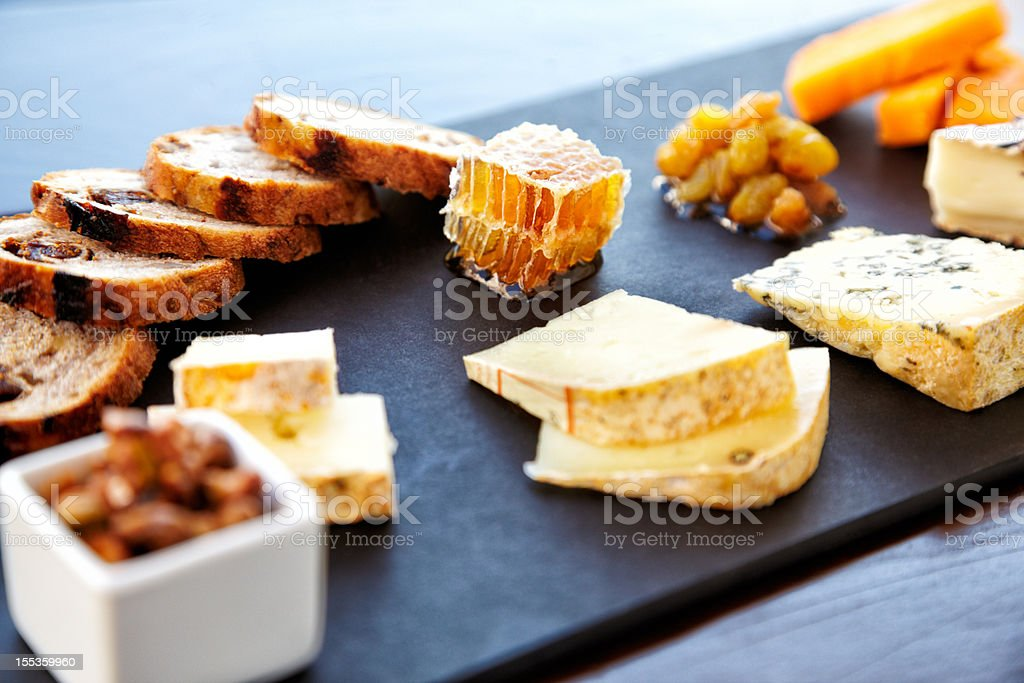 Fancy cheese plate with bread and honey stock photo