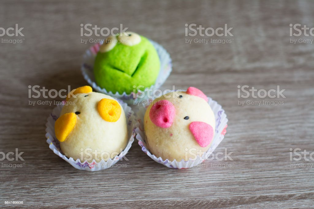 Fancy cookies on wooden table, frog and pigs cookies royalty-free stock photo