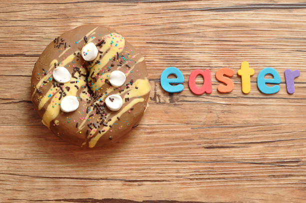 A Fancy Decorated Doughnut With The Word Easter Stock Photo